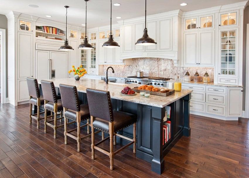 L shape kitchen with high end furnishings and white cabinets