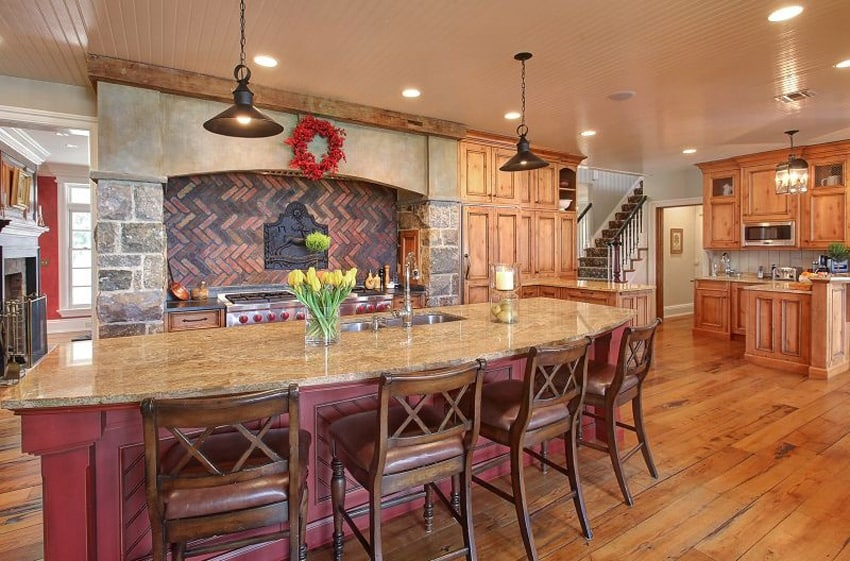 Luxury kitchen with bordeaux granite and large wolf six burner stove