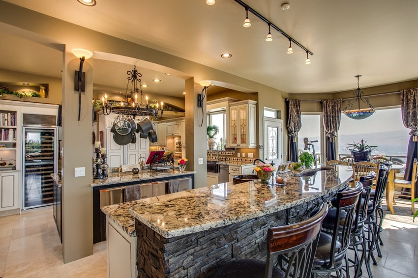 Luxury waterfront kitchen with stone front island