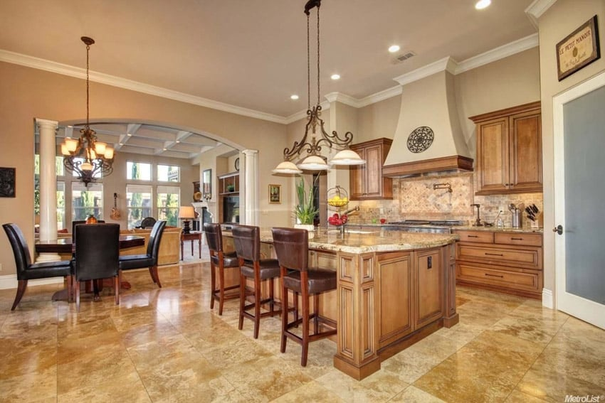 Open kitchen with barricato granite and large island with eat-in dining