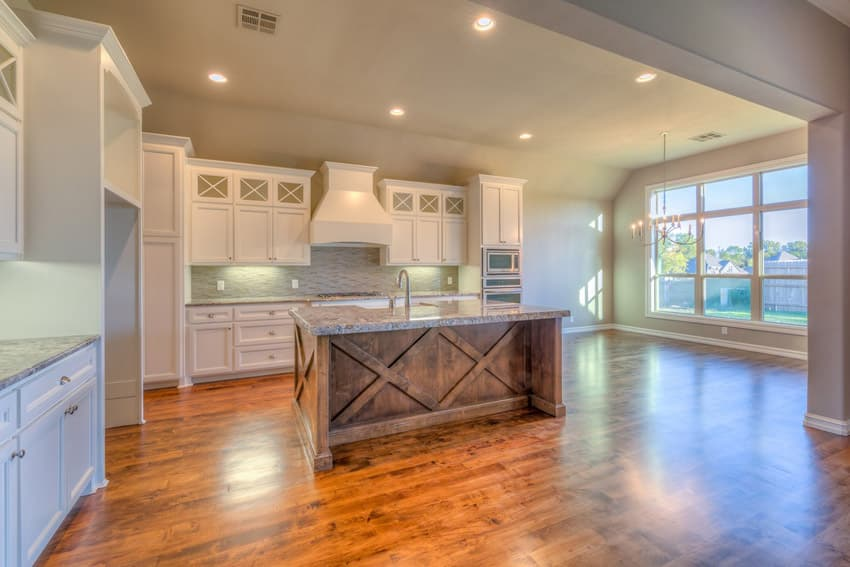 Open layout kitchen with white ravine granite counters