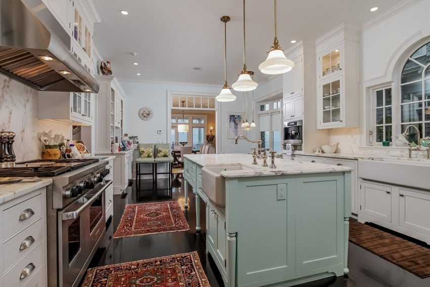 kitchen with white marble counters, farmhouse sink, and mint green