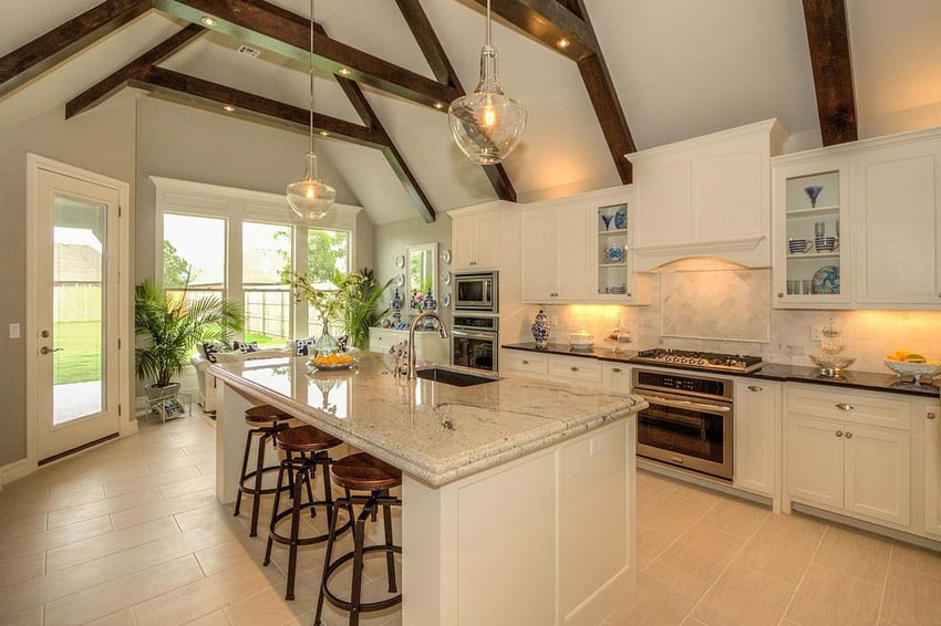 Traditional kitchen with ivory fantasy granite counter and island