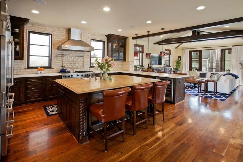 U shaped kitchen with wood floors and subway tile backsplash