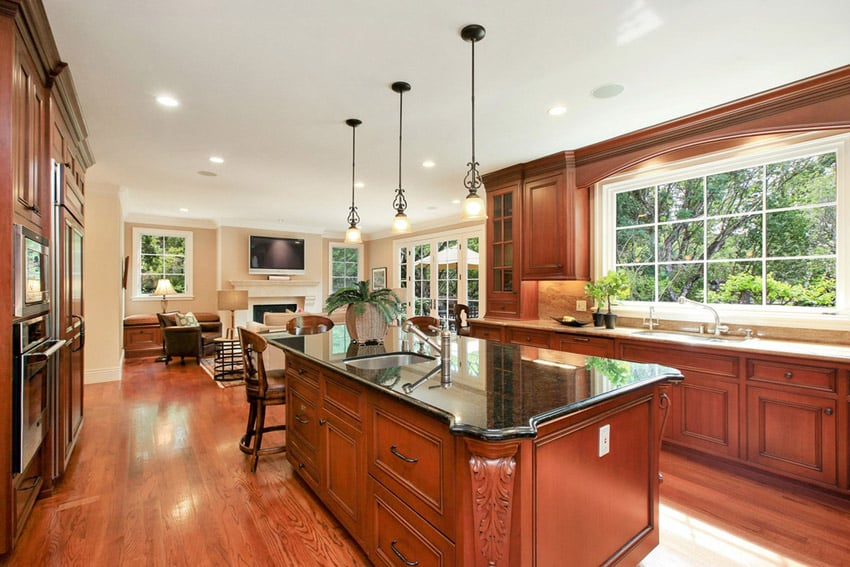 Wood kitchen with emerald pearl counters and teak engineered wood floors