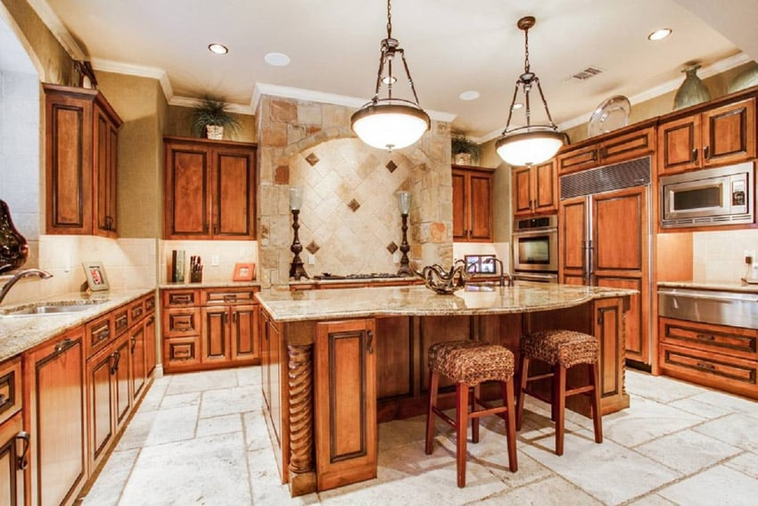 Wood kitchen with granite slab counters and large pendant lights