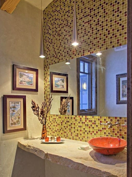 Bathroom with square mosaic tile and brushed metal pendant lights