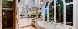beautiful-master-bath-with-tub-and-pendant-lights-with-hanging-glass