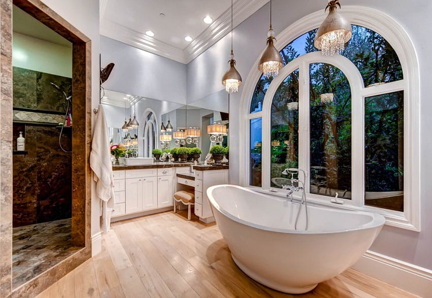 beautiful master bath with tub and pendant lights with hanging glass bathroom pendant lighting