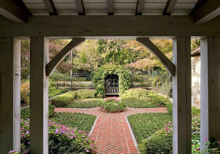 Brick walkway with chevron pattern through garden