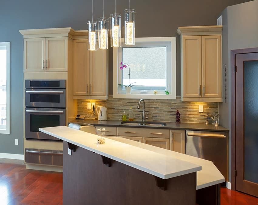 Compact contemporary kitchen with light yellow cabinetry