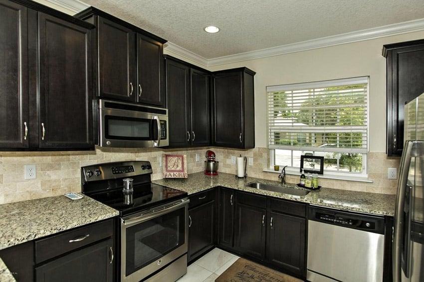 Compact corner kitchen with barcelona granite countertops