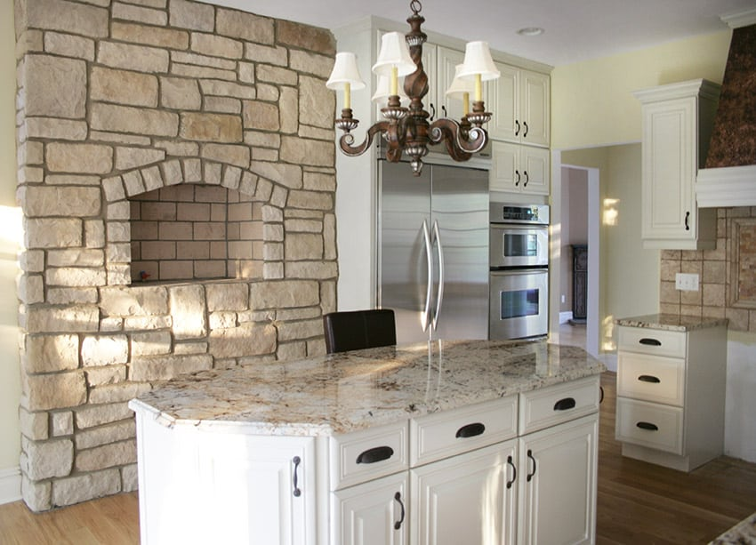 Compact kitchen with stone wall light granite and white cabinets