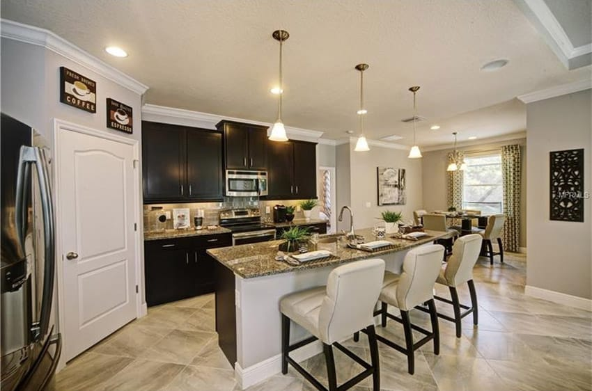 Compact kitchen with tropic brown granite countertops