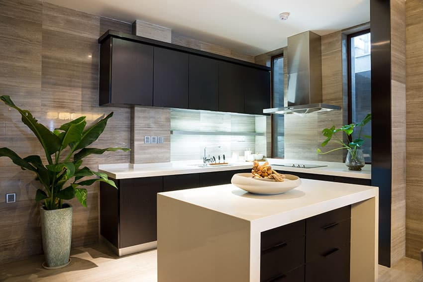 Compact modern kitchen with white counters and brown cabinets