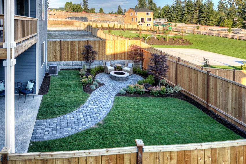Concrete paver pathway to firepit with outdoor seating