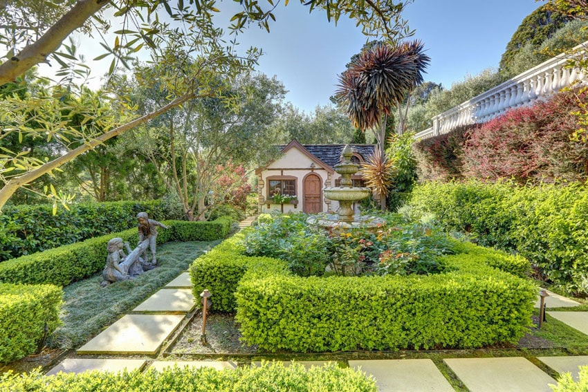 Concrete tile steps in landscaped garden with fountain