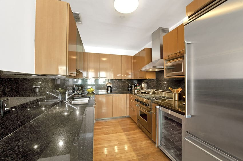 Contemporary galley kitchen with European cabinets
