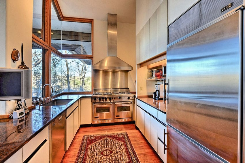 Contemporary galley kitchen with stove at end of room