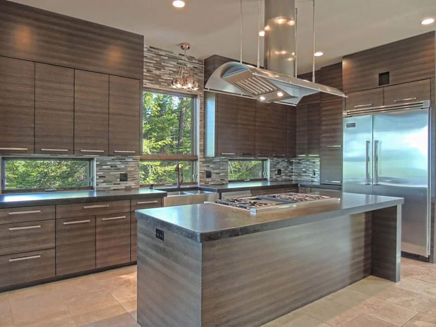 Contemporary kitchen with dark cabinetry glass mosaic tile backsplash