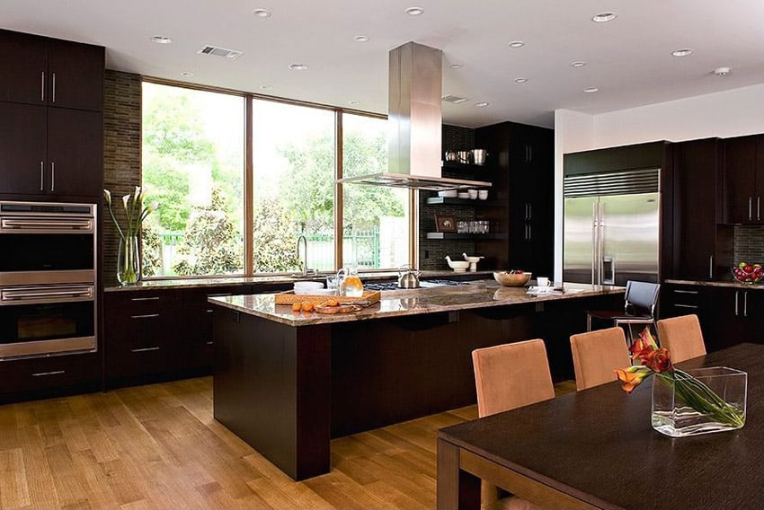 Contemporary kitchen with long island and hickory wood flooring