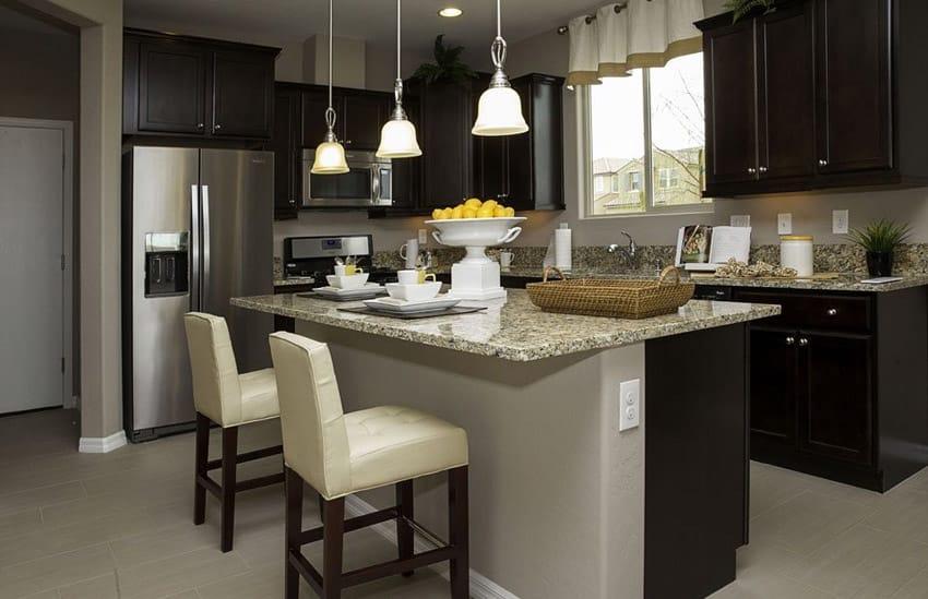 Contemporary kitchen with peppercorn white quartz counter