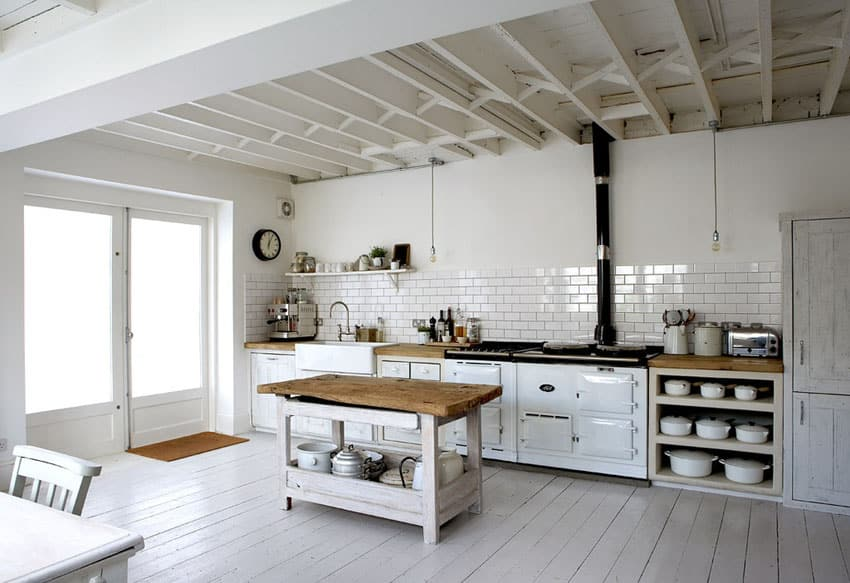 Country kitchen moveable island with wood countertop and rustic style