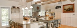 country-kitchen-with-bianco-carrara-marble-counters-and-exposed-beam-ceiling