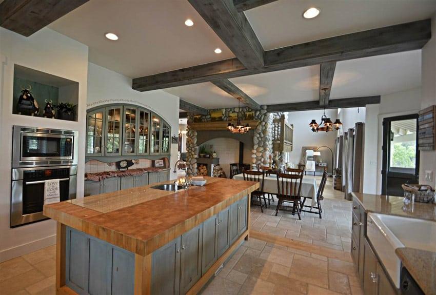 Country kitchen with exposed beam high ceilings