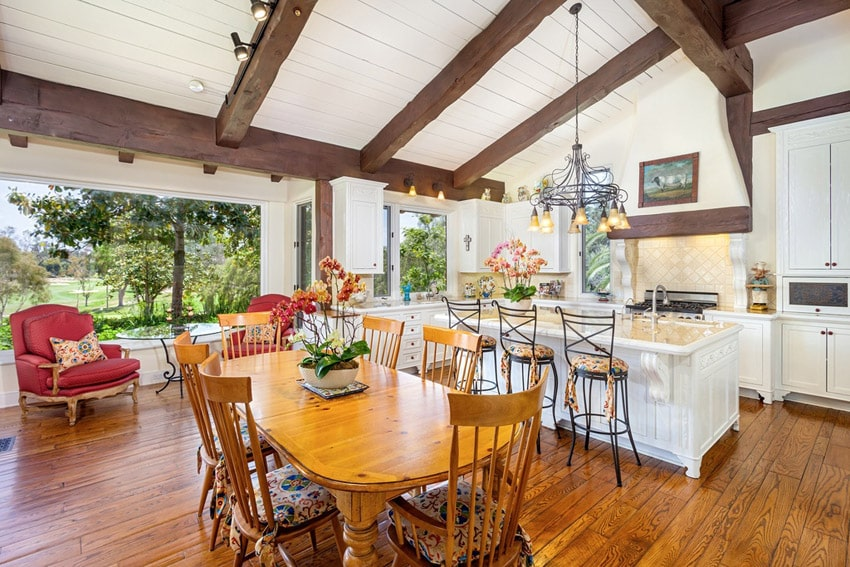 Country kitchen with exposed beams white cabinets