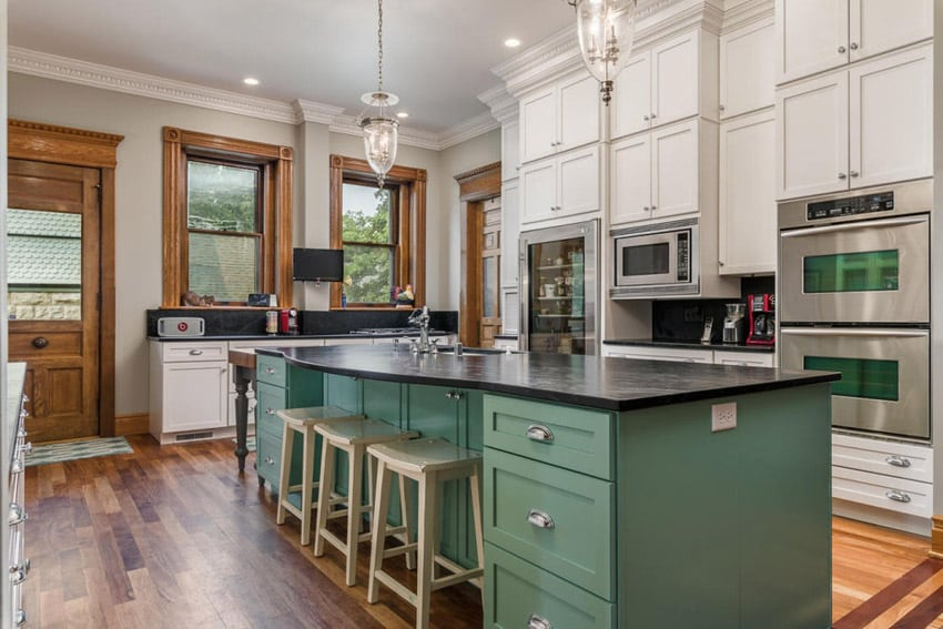 Country kitchen with soapstone countertops and green painted island