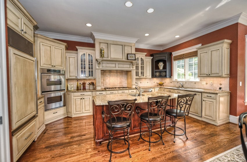 Country kitchen with tile backsplash and breakfast bar