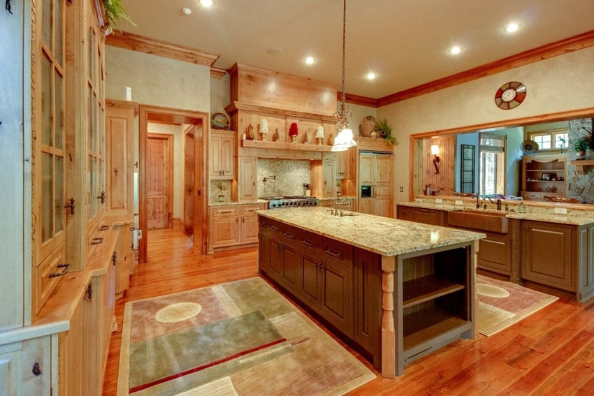 Bright country kitchen with white granite counter and cherry wood flooring