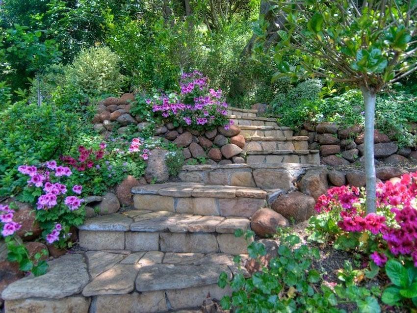 Fieldstone steps through flower garden and bushes