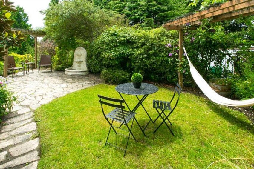 Flagstone patio with path in relaxing backyard