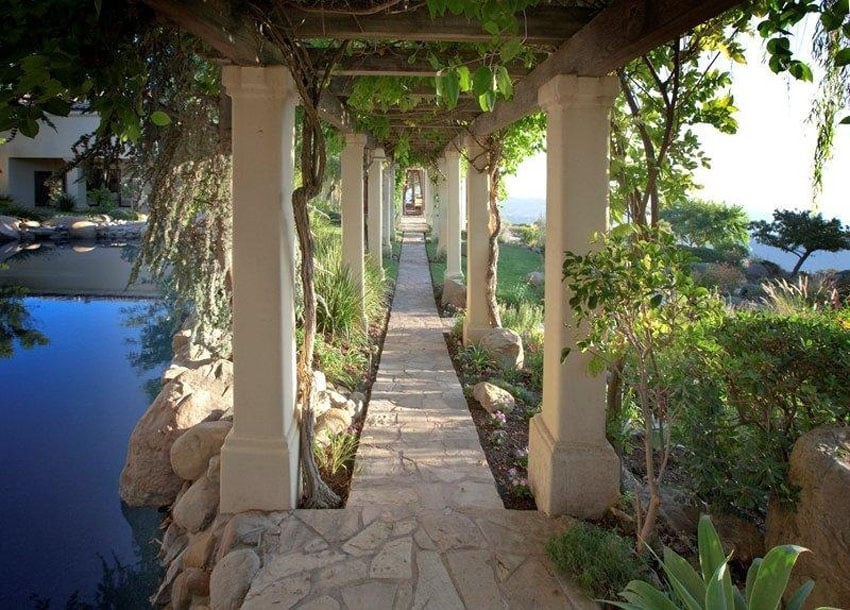 Flagstone paved tile walkway by pool