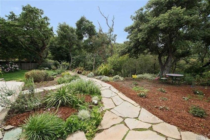 Flagstone walkway through landscaped yard
