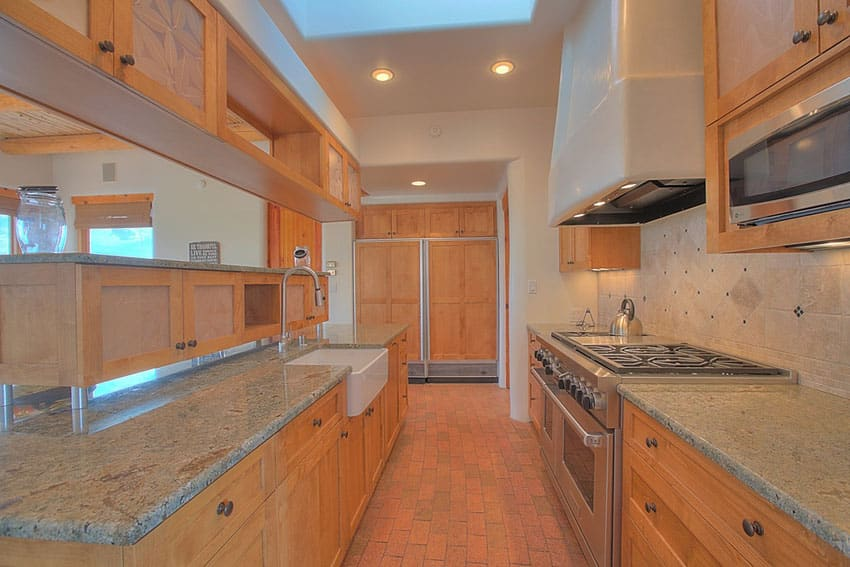 Galley kitchen with farmhouse sink limestone tile