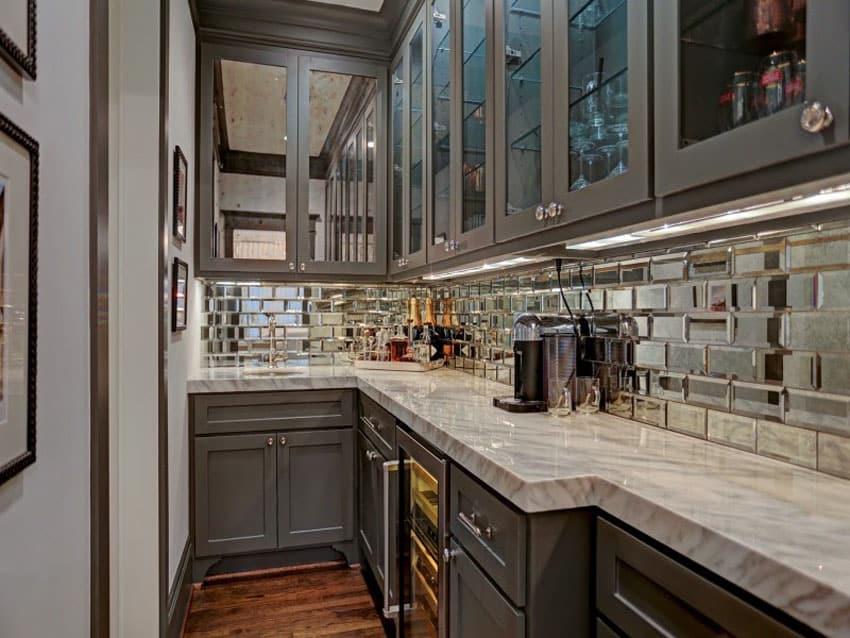 Galley kitchen with shiny mirror metal backsplash