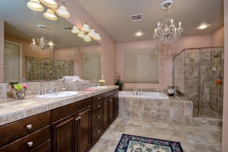 Great looking bathroom with decorative chandelier
