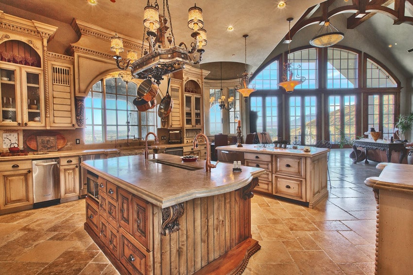 High end luxury kitchen with wood island and breakfast bar