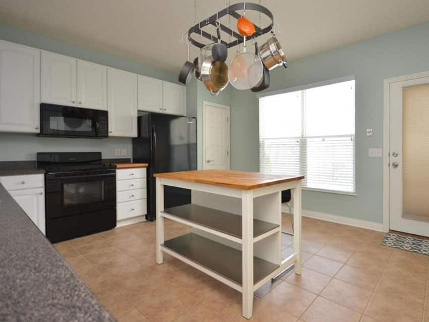 Kitchen with ikea island by stenstorp with wood counter