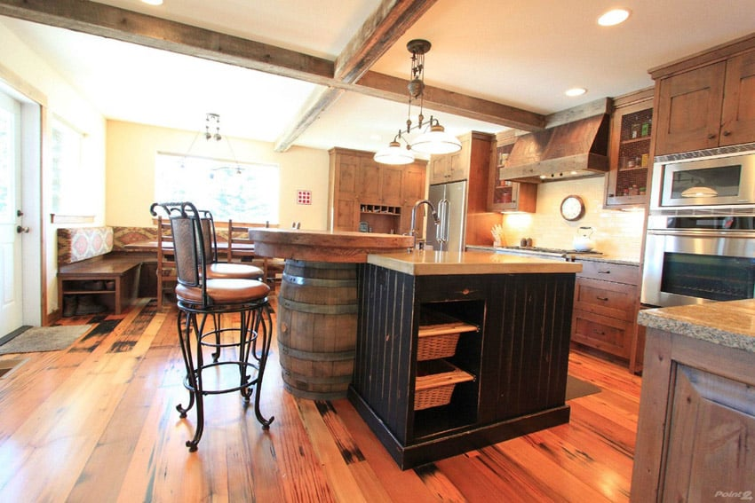 Rustic style kitchen with wine barrel island, exposed beams and wood flooring