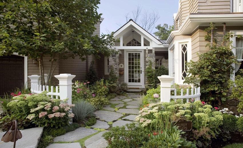 Large flagstone walkway in english style cottage backyard