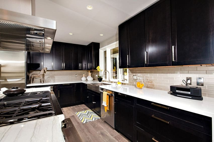 Luxury galley kitchen with dark cabinets and white counters