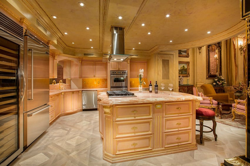 Luxury kitchen with bright cabinetry open to formal living room