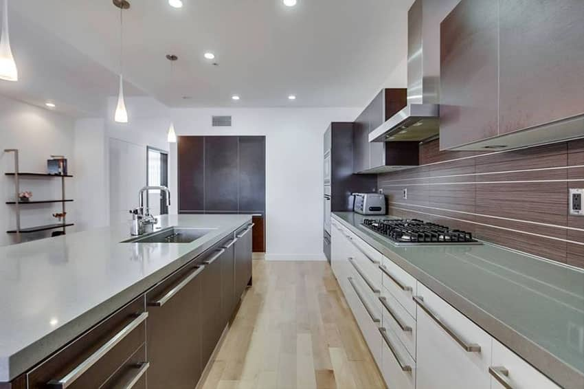 Modern galley kitchen with concrete countertops
