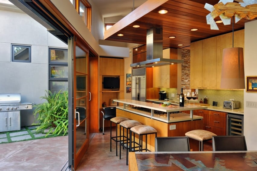 Modern kitchen with breakfast bar island and sliding door to back patio