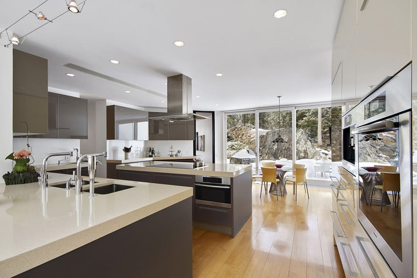 Modern kitchen with white quartz counters two color cabinets