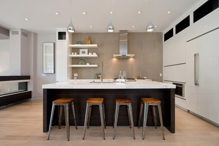 Modern open kitchen with calacutta marble counters